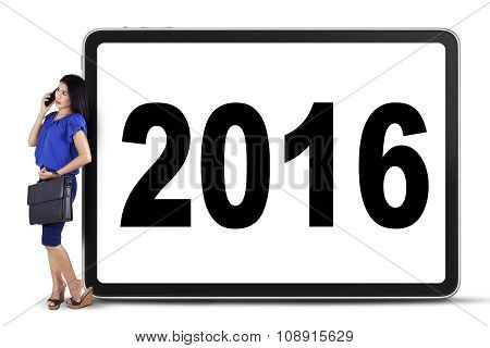 Businesswoman With Numbers 2016 On The Board