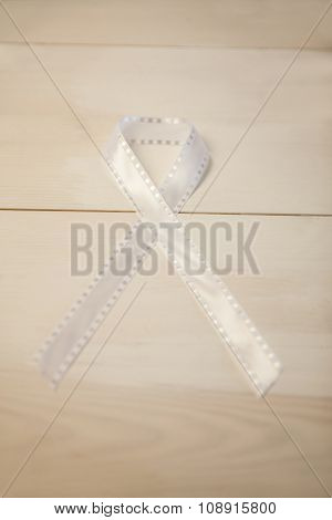 White ribbon on wooden desk shot in studio