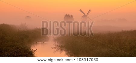 Dutch Landscape With Historic Windmill
