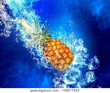 Fresh pineapple in clear blue water splashes