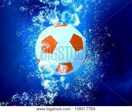 Soccer ball sink in clear blue water