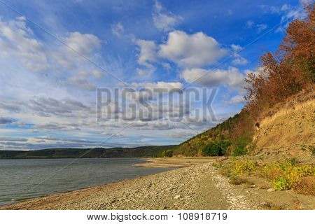 scene on lake shore in nice autumn day