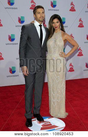 LAS VEGAS - NOV 19:  Eric Winter, Roselyn Sanchez at the 16th Latin GRAMMY Awards at the MGM Grand Garden Arena on November 19, 2015 in Las Vegas, NV