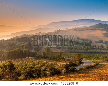 Tuscan Village During Foggy Sunrise