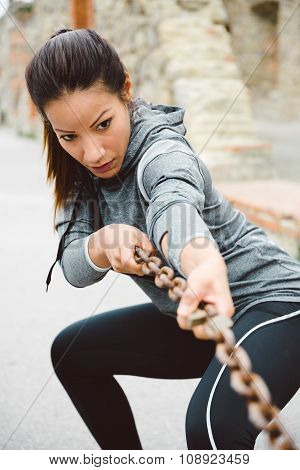 Fitness Woman Pulling Chain For Working Out