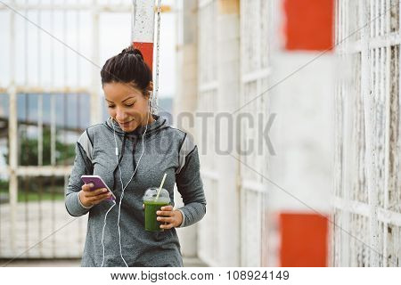 Urban Fitness Woman Texting On Her Smarphone