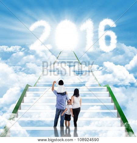 Happy Family Climbing Stairs Toward Numbers 2016