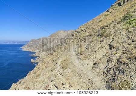 The Trail On The Steep Hillside Above The Sea.