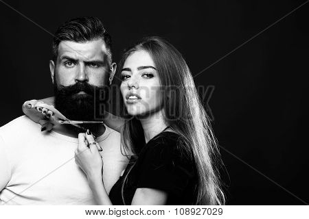 Woman Cuttin Male Beard