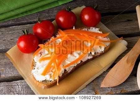 Fresh Curd Cheese On Bread With Carrot