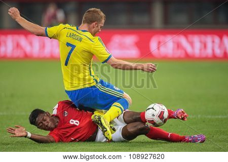 VIENNA, AUSTRIA - SEPTEMBER 9, 2014: David Alaba (#8 Austria) and Sebastian Larsson (#7 Sweden) fight for the ball in an European Championship qualifying game.