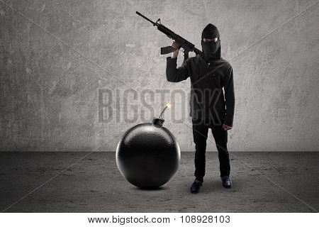 Male Rebel With Bomb And Holding Rifle