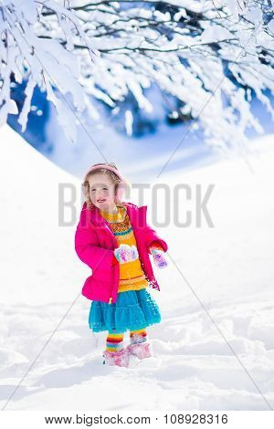 Little Girl Playing In Snowy Winter Park