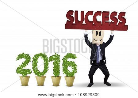 Man Lifting A Success Text With Numbers 2016