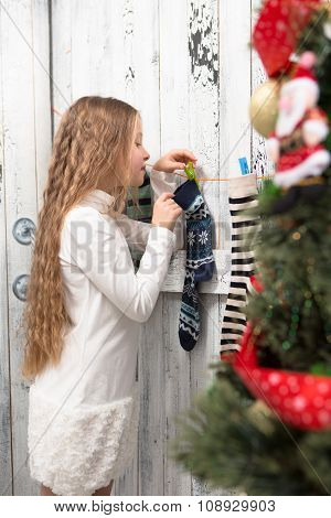 Teenage girl looking into New Year and Christmas socks
