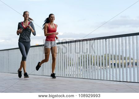 Fit Women Jogging Outdoors