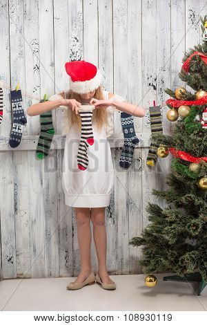 Teenage girl looking into New Year and Christmas socks