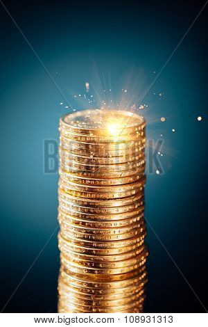 golden dollar coins stack on blue background