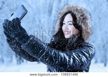 Pretty Girl With Winter Clothes Taking Photo