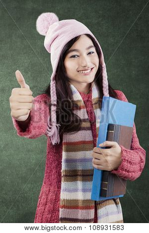 Pretty Student With Book Showing Thumbs-up