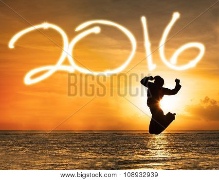 Silhouette Of Woman Jumping Under Numbers 2016