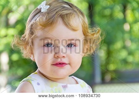 Cute Infant With Curly Blond Hair
