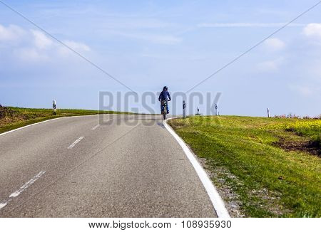 Young Boy On Tour With The Bike