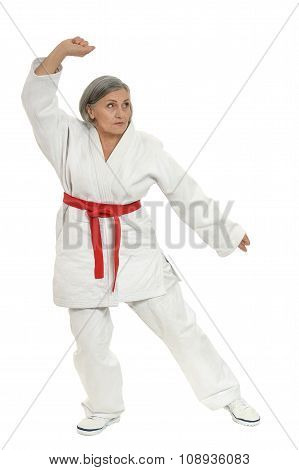 Senior woman in karate pose