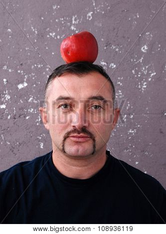 Man with apple on a head