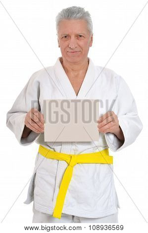 Karate  Senior man   with poster