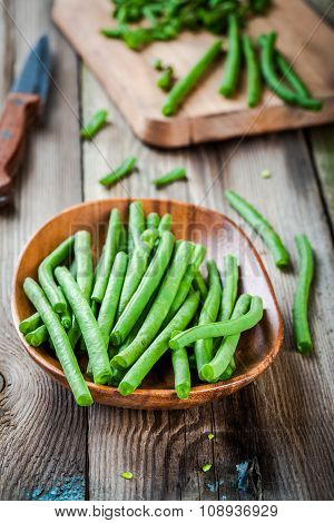 Pods Of Fresh Organic Green Beans In A Wooden Bowl