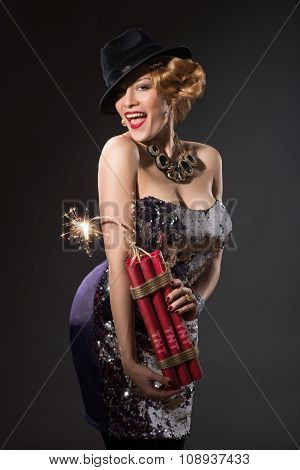 woman in vintage style dress and hat holding dynamite
