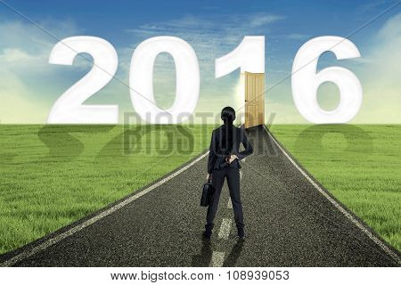 Woman Looking At Number 2016 On The Street