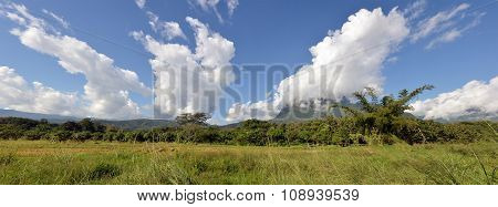 Grass, mountain and cloudy sky panoramic view of Chiangmai Thailand