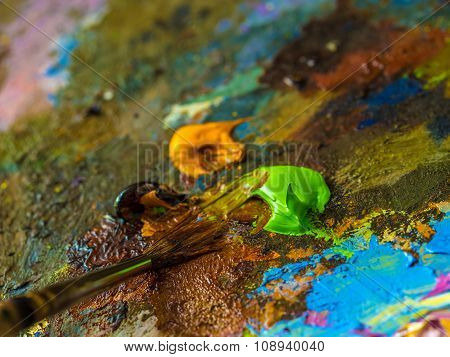 Paintbrush On The Palette For Mixing Oil Paints