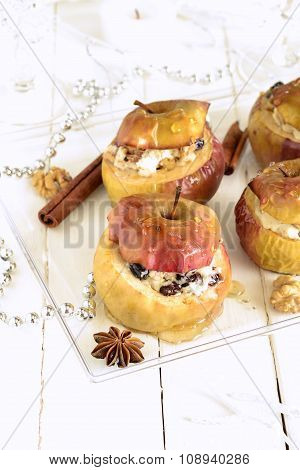 Baked apple stuffed with walnuts, raisins, cottage cheese and honey