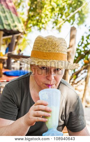 Woman Has A Fruit Drink In The Tropical   Restaurant