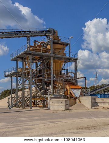 Close Up Of A Sand Sorting Machine Under Blue Clouded Sky