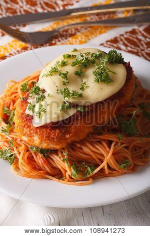 Italian Chicken Parmigiana And Pasta Close Up On A Plate. Vertical