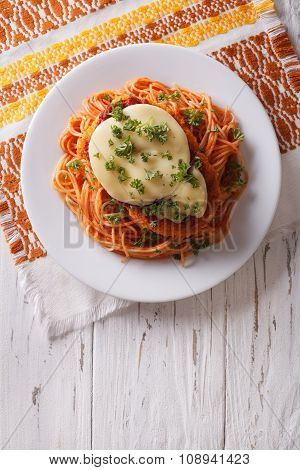 Italian Chicken Parmigiana And Pasta. Vertical Top View