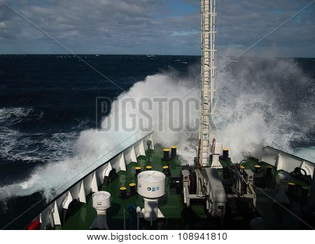 Big Wave Rolling Over The Snout Of The Ship