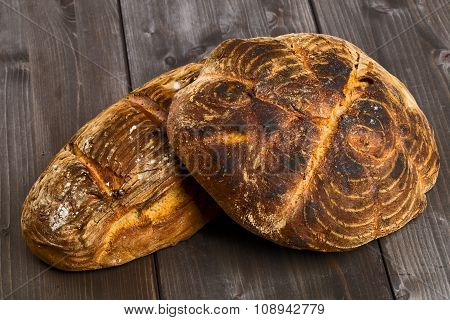 Hand Made Bread Loaves On Wooden Table