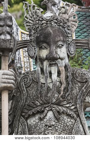 Statue Of A Chinese Warrior Near An Entrance Of Wat Pho. Wat Pho Is A Buddhist Temple Complex In The