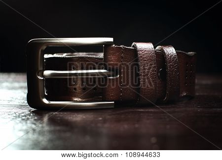 Brown Leather Belt On A Wooden Background