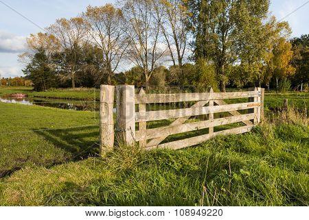 Hardwood Gate Between Wooden Posts In A Rural Area