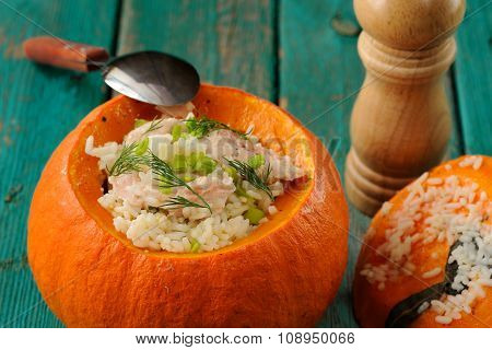 Roasted Whole Pumpkin With Rice And Meat With Pepper Mill