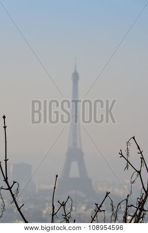 The Eiffel Tower In The Morning Mist