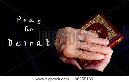 Pray For Beirut. The Hands Of Senior Woman On The Koran