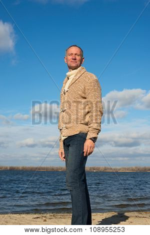 Smiling Man, Wearing Casually, Walking Along The Coast , Looking Into The Distance