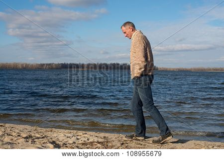 Happy Man, Wearing Casually, Walking Along The Coast